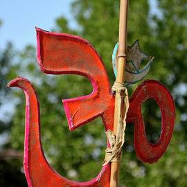 Imran Ahmed - Hindu Om and Muslim crescent star symbols hang together outside temple Tharparkar Sindh Pakistan