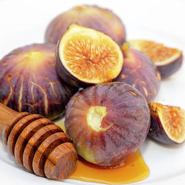 Honey And Figs On A Plate by Paul Cowan