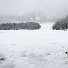 Nicola Simeoni - In the forest of Lake Fusine during snowfall.
