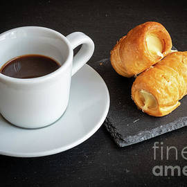 Italian breakfast. Cannoncini and espresso by Marina Usmanskaya