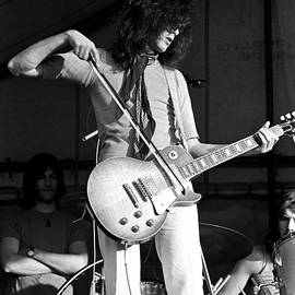 Jimmy Page With Bow 1969 by Chris Walter