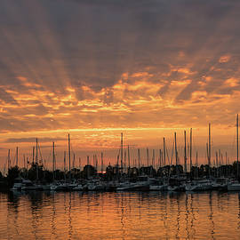 Just a Sliver of the Sun - Sunrise God Rays at the Marina by Georgia Mizuleva