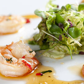 KING PRAWNS GINGER CHILLI AND CORIANDER starter presented on a white background by Andy Smy