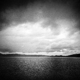 Lake and dramatic sky black and white