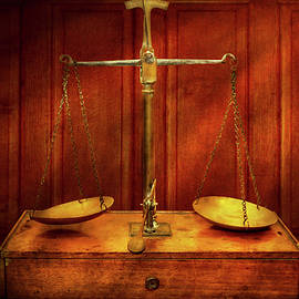 Lawyer - Unbalanced scale of justice by Mike Savad