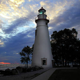 Lighthouse At Sunrise by Angela Murdock
