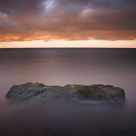 Lone Stone at Sunrise by Adam Romanowicz