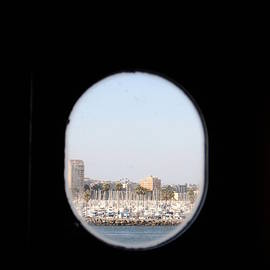 Long Beach Through A Porthole Of Queen Mary by Colleen Cornelius
