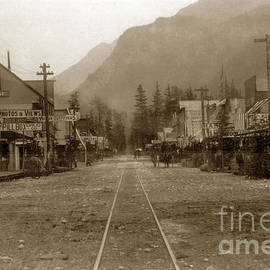 Looking Down Street With R/ R Tracks Burrhard House White Pass And Yukon Route Railroad 1898 by California Views Archives Mr Pat Hathaway Archives