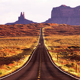 Magestic and Lonesome Road To Monument Valley by Kim Lessel