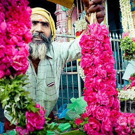 Man With Flowers Near The Temple Kerala Yatra 2016 Yantra by Raimond Klavins