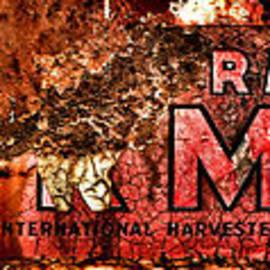 McCormick Farmall Grunge Logo - Olivier Le Queinec