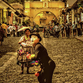 Mimo and Umbrella Vendor - Antigua Guatemala II by Totto Ponce