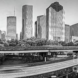 Monochrome Panorama of Downtown Houston Skyline from Buffalo Bayou Park - Harris County Houston Texa by Silvio Ligutti