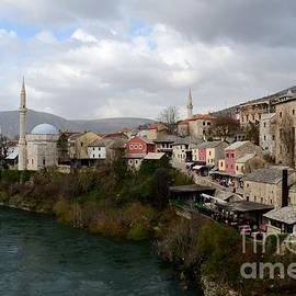Mostar city with mosque minaret medieval architecture Neretva river Bosnia Herzegovina by Imran Ahmed