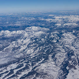 Mountains as Far as the Eye Can See - Winter Flight Over the Rockies by Georgia Mizuleva