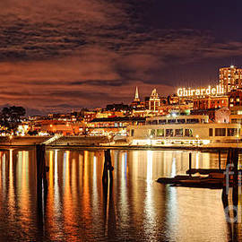 Night Panorama of Fisherman's Wharf and Ghirardelli Square - San Francisco California by Silvio Ligutti