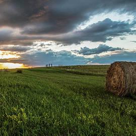 North Dakota Sunset With Hay by John McGraw