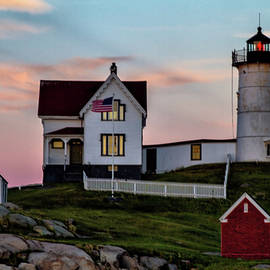 Nubble Lighthouse At Dusk  by Betty Pauwels