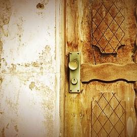 Old And Damaged Door With Metal Lock by Airo Zamoner