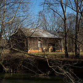 Old Barn by the River by Jeff Roney
