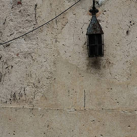 Old Lantern On A Weathered Wall