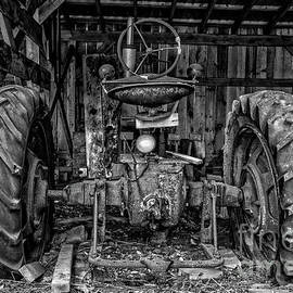 Old Tractor in the Barn Black and White by Edward Fielding