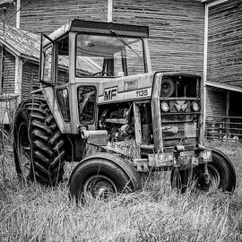 Old Vintage Tractor on a farm in New Hampshire Square