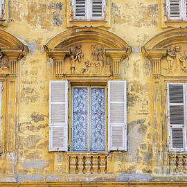 Liesl Walsh - Old Yellow Building With Lace Curtain in Nice, France