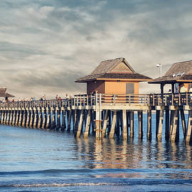 On A Cloudy Day at Naples Pier by Kim Hojnacki