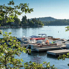 Overlooking a pier and boats on Lake Arrowhead, CA by Bradley Hebdon