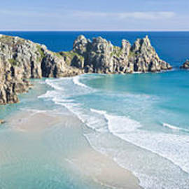 Logan Rock and Pednvounder beach, Porthcurno, Cornwall. by Justin Foulkes