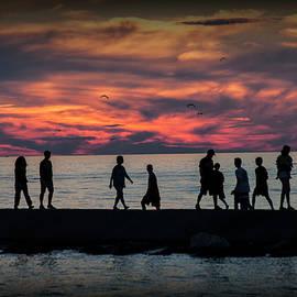 Randall Nyhof - People walking on the Breakwater at Ottawa Beach at Sunset
