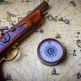 Pistole And Compass On Old Map - Garry Gay