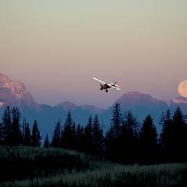 Plane Over Setting Moon