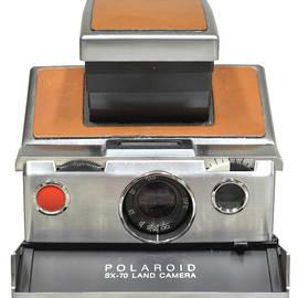 Polaroid Sx70 On White by Brian N Duram