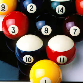 Pool balls on tiles by Garry Gay