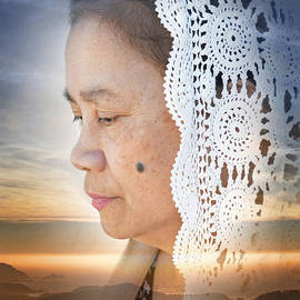 Profile Portrait of a Filipina Woman Wearing a veil and Deep in Thought At Sunset