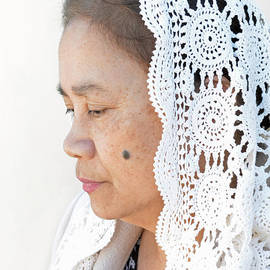 Profile Portrait of a Filipina Woman Wearing a Veil and Deep in Thought II