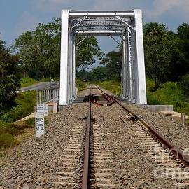 Imran Ahmed - Railway bridge with rail tracks parallel to highway in Sri Lanka