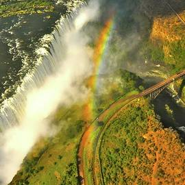 Rainbow Over Victoria Falls by Don Mercer