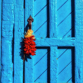 Red Chilis Hanging On Blue Door - Garry Gay