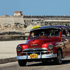Red Plymouth in Havana by Dawn Currie