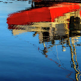 Reflection of a Fishing Boat