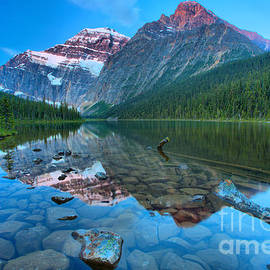 Reflections And Boulders At Cavell Lake by Adam Jewell