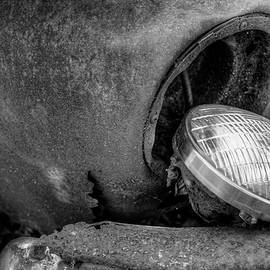 Resting Headlight Of Rusty Car by Dennis Dame