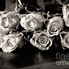 Roses on a table in black and white by Simon Bratt Photography LRPS