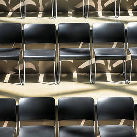 Rows Of Empty Chairs In A Meeting Hall by Bryan Mullennix