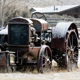 Rusty Tractor in the Snow by Michael Riley