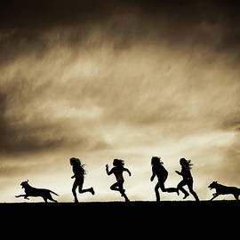 Maggie McCall - Silhouettes of running Girls and Dogs